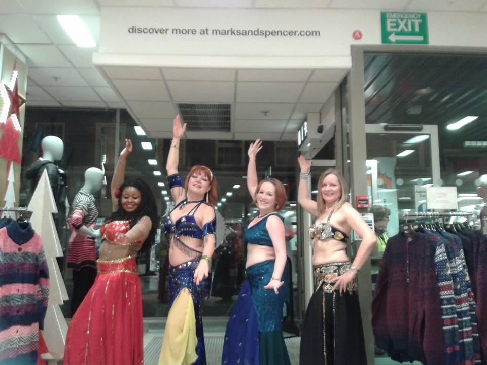 Superstar students from Rachel Bennett School of Bellydance showcasing their talents at Marks and Spencers in Wokingham, as part of Wokingham's Living Advent Calendar event.
